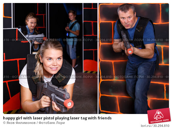 Купить «happy girl with laser pistol playing laser tag with friends», фото № 30294810, снято 3 сентября 2018 г. (c) Яков Филимонов / Фотобанк Лори