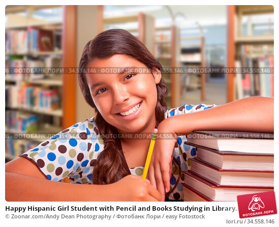 Happy Hispanic Girl Student with Pencil and Books Studying in Library. Стоковое фото, фотограф Zoonar.com/Andy Dean Photography / easy Fotostock / Фотобанк Лори