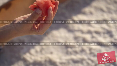 Купить «happy smiling girl enjoying the sunset, eating watermelon, sit on salt, close-up», видеоролик № 29407074, снято 10 ноября 2018 г. (c) Ирина Мойсеева / Фотобанк Лори