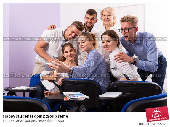 Купить «Happy students doing group selfie», фото № 28163322, снято 5 октября 2017 г. (c) Яков Филимонов / Фотобанк Лори