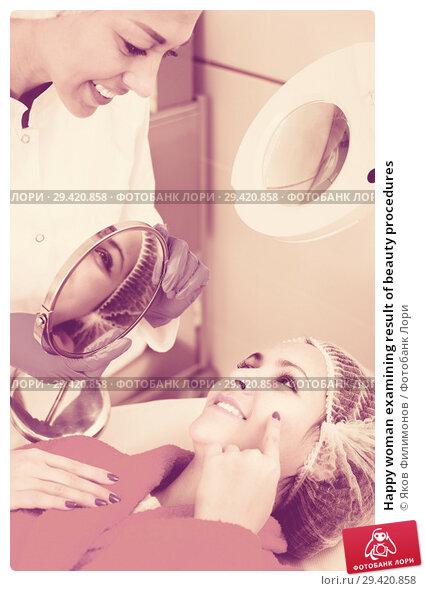 Купить «Happy woman examining result of beauty procedures», фото № 29420858, снято 23 апреля 2019 г. (c) Яков Филимонов / Фотобанк Лори