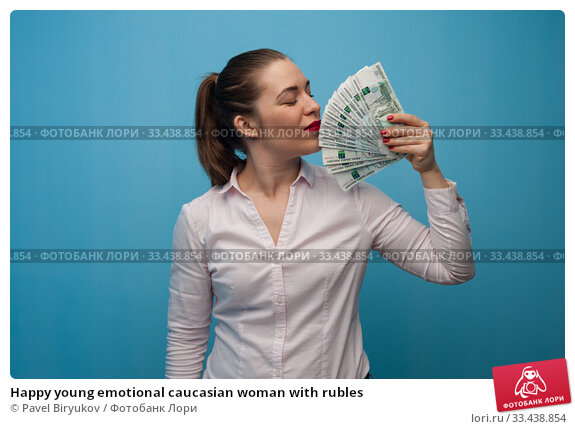 Купить «Happy young emotional caucasian woman with rubles», фото № 33438854, снято 12 марта 2019 г. (c) Pavel Biryukov / Фотобанк Лори