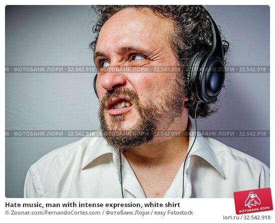 Купить «Hate music, man with intense expression, white shirt», фото № 32542918, снято 10 декабря 2019 г. (c) easy Fotostock / Фотобанк Лори