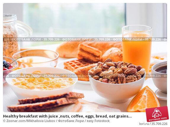 Healthy breakfast with juice ,nuts, coffee, eggs, bread, oat grains... Стоковое фото, фотограф Zoonar.com/Mikhailova Liubov / easy Fotostock / Фотобанк Лори