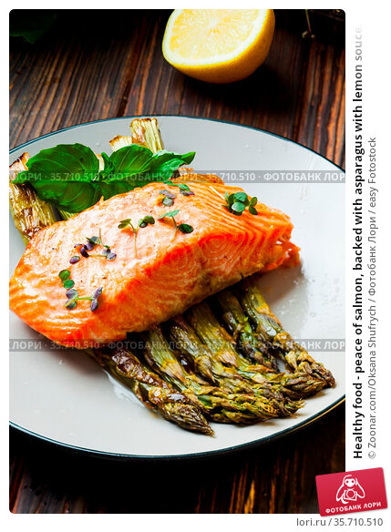Healthy food - peace of salmon, backed with asparagus with lemon souce... Стоковое фото, фотограф Zoonar.com/Oksana Shufrych / easy Fotostock / Фотобанк Лори
