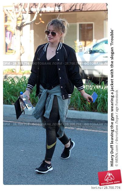 Купить «Hilary Duff leaving the gym wearing a jacket with the slogan 'Trouble' Featuring: Hilary Duff Where: Los Angeles, California, United States When: 28 Dec 2016 Credit: WENN.com», фото № 28700774, снято 28 декабря 2016 г. (c) age Fotostock / Фотобанк Лори