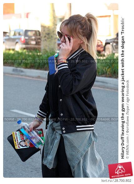 Купить «Hilary Duff leaving the gym wearing a jacket with the slogan 'Trouble' Featuring: Hilary Duff Where: Los Angeles, California, United States When: 28 Dec 2016 Credit: WENN.com», фото № 28700802, снято 28 декабря 2016 г. (c) age Fotostock / Фотобанк Лори