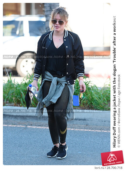 Купить «Hilary Duff wearing a jacket with the slogan 'Trouble' after a workout Featuring: Hilary Duff Where: Los Angeles, California, United States When: 28 Dec 2016 Credit: WENN.com», фото № 28700718, снято 28 декабря 2016 г. (c) age Fotostock / Фотобанк Лори