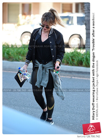 Купить «Hilary Duff wearing a jacket with the slogan 'Trouble' after a workout Featuring: Hilary Duff Where: Los Angeles, California, United States When: 28 Dec 2016 Credit: WENN.com», фото № 28700742, снято 28 декабря 2016 г. (c) age Fotostock / Фотобанк Лори