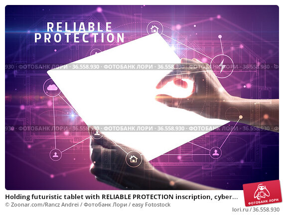 Holding futuristic tablet with RELIABLE PROTECTION inscription, cyber... Стоковое фото, фотограф Zoonar.com/Rancz Andrei / easy Fotostock / Фотобанк Лори