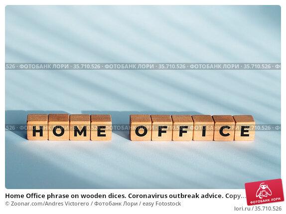 Home Office phrase on wooden dices. Coronavirus outbreak advice. Copy... Стоковое фото, фотограф Zoonar.com/Andres Victorero / easy Fotostock / Фотобанк Лори