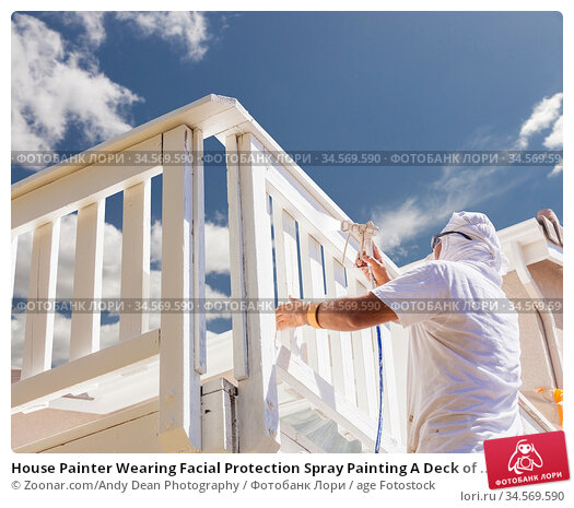 House Painter Wearing Facial Protection Spray Painting A Deck of ... Стоковое фото, фотограф Zoonar.com/Andy Dean Photography / age Fotostock / Фотобанк Лори