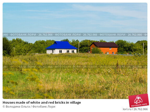 Купить «Houses made of white and red bricks in village», фото № 26762066, снято 10 августа 2017 г. (c) Володина Ольга / Фотобанк Лори
