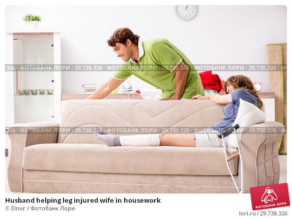 Купить «Husband helping leg injured wife in housework», фото № 29738326, снято 4 октября 2018 г. (c) Elnur / Фотобанк Лори