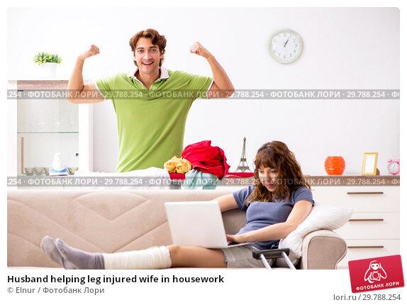 Купить «Husband helping leg injured wife in housework», фото № 29788254, снято 4 октября 2018 г. (c) Elnur / Фотобанк Лори
