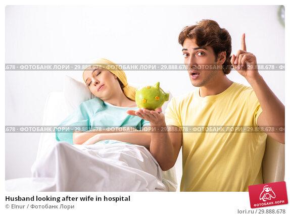 Купить «Husband looking after wife in hospital», фото № 29888678, снято 3 октября 2018 г. (c) Elnur / Фотобанк Лори