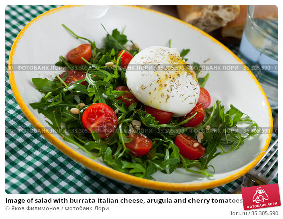 Image of salad with burrata italian cheese, arugula and cherry tomatoes. Стоковое фото, фотограф Яков Филимонов / Фотобанк Лори