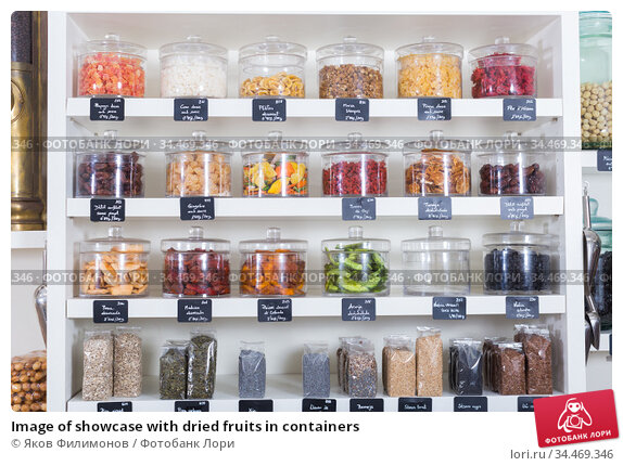 Image of showcase with dried fruits in containers. Стоковое фото, фотограф Яков Филимонов / Фотобанк Лори