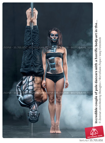 Incredible couple of pole dancers with a horrific body-art in the... Стоковое фото, фотограф Zoonar.com/Andrey Bezuglov / easy Fotostock / Фотобанк Лори