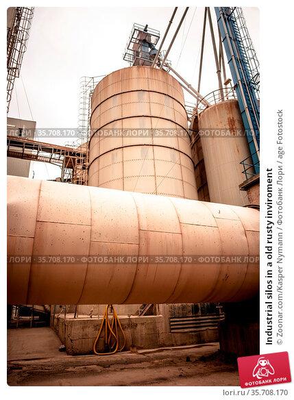 Industrial silos in a old rusty inviroment. Стоковое фото, фотограф Zoonar.com/Kasper Nymann / age Fotostock / Фотобанк Лори