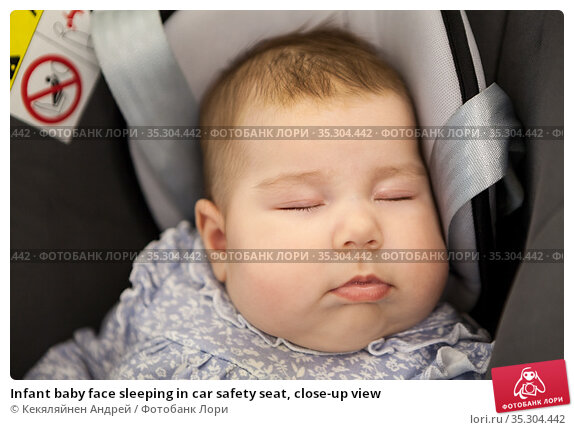 Infant baby face sleeping in car safety seat, close-up view. Стоковое фото, фотограф Кекяляйнен Андрей / Фотобанк Лори