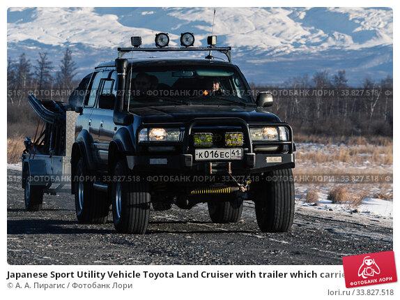 Купить «Japanese Sport Utility Vehicle Toyota Land Cruiser with trailer which carries snowmobile driving along road on background winter landscape», фото № 33827518, снято 7 января 2016 г. (c) А. А. Пирагис / Фотобанк Лори