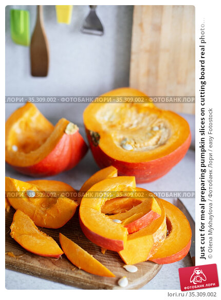 Just cut for meal preparing pumpkin slices on cutting board real photo... Стоковое фото, фотограф Olena Mykhaylova / easy Fotostock / Фотобанк Лори