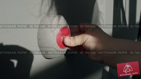 Kid pressing Stop button on a bus. Стоковое видео, видеограф Данил Руденко / Фотобанк Лори