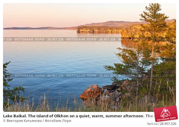 Купить «Lake Baikal. The island of Olkhon on a quiet, warm, summer afternoon. The rocks of Cape Tashkay in the sunset. Beautiful summer calm landscape», фото № 28957326, снято 8 августа 2018 г. (c) Виктория Катьянова / Фотобанк Лори