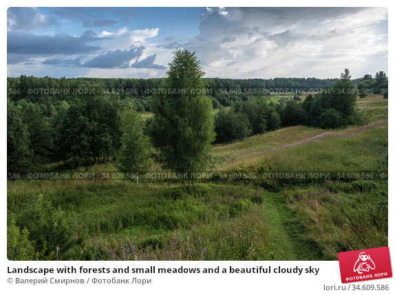 Landscape with forests and small meadows and a beautiful cloudy sky. Стоковое фото, фотограф Валерий Смирнов / Фотобанк Лори