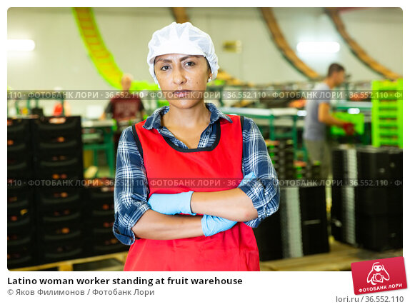 Latino woman worker standing at fruit warehouse. Стоковое фото, фотограф Яков Филимонов / Фотобанк Лори