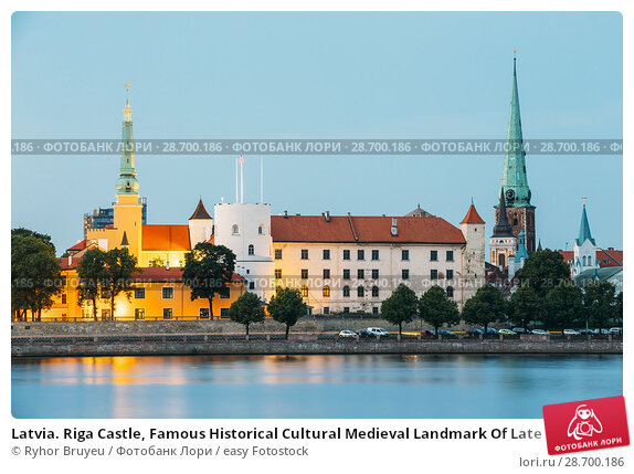 Купить «Latvia. Riga Castle, Famous Historical Cultural Medieval Landmark Of Late Classicism And Official President Residence On Embankment Of Daugava River In Evening Illumination With Summer Blue Sky.», фото № 28700186, снято 30 июня 2016 г. (c) easy Fotostock / Фотобанк Лори
