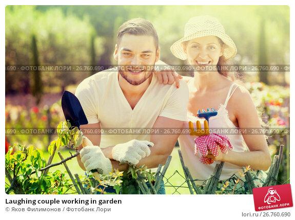 Купить «Laughing couple working in garden», фото № 26760690, снято 24 ноября 2017 г. (c) Яков Филимонов / Фотобанк Лори