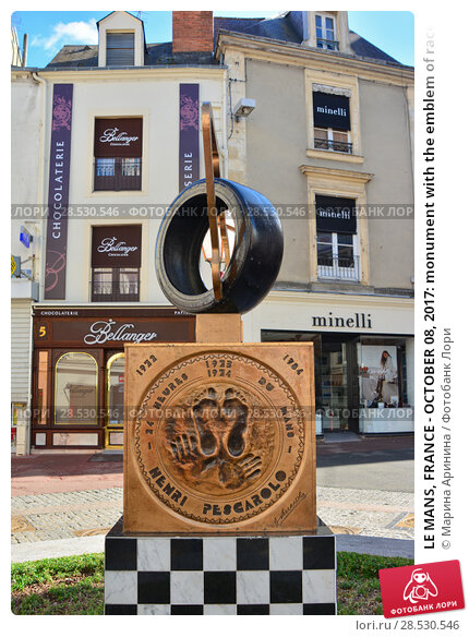 Купить «LE MANS, FRANCE - OCTOBER 08, 2017: monument with the emblem of races 24 hours le mans and the impressions of the hands of the winners», фото № 28530546, снято 8 октября 2017 г. (c) Ирина Кучугурина / Фотобанк Лори