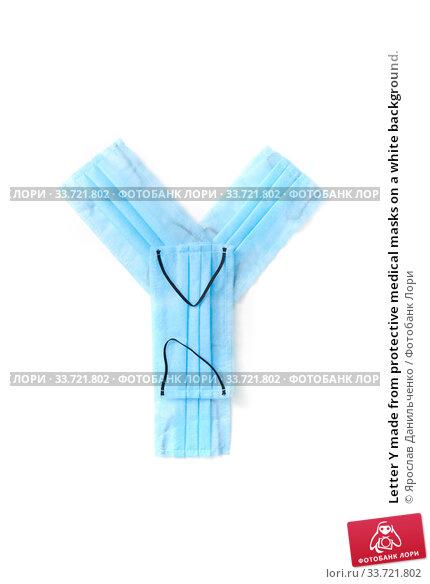 Купить «Letter Y made from protective medical masks on a white background.», фото № 33721802, снято 2 мая 2020 г. (c) Ярослав Данильченко / Фотобанк Лори