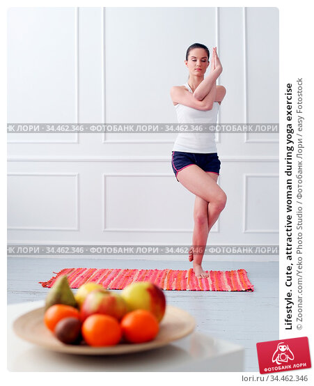 Lifestyle. Cute, attractive woman during yoga exercise. Стоковое фото, фотограф Zoonar.com/Yeko Photo Studio / easy Fotostock / Фотобанк Лори