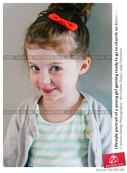 Lifestyle portrait of a young girl getting ready to go to church on Easter Sunday., фото № 26335106, снято 15 апреля 2017 г. (c) easy Fotostock / Фотобанк Лори