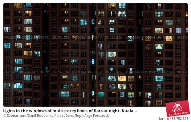 Lights in the windows of multistorey block of flats at night. Kuala... Стоковое фото, фотограф Zoonar.com/Danil Roudenko / age Fotostock / Фотобанк Лори