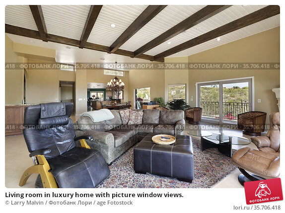 Living room in luxury home with picture window views. Редакционное фото, фотограф Larry Malvin / age Fotostock / Фотобанк Лори