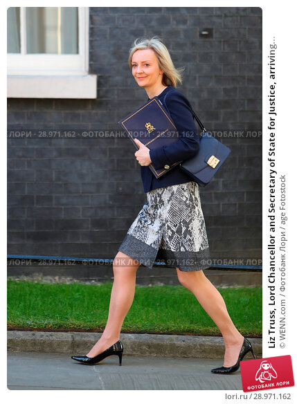Купить «Liz Truss, Lord Chancellor and Secretary of State for Justice, arriving for the weekly cabinet meeting at 10 Downing Street in Whitehall, London. Featuring...», фото № 28971162, снято 25 апреля 2017 г. (c) age Fotostock / Фотобанк Лори