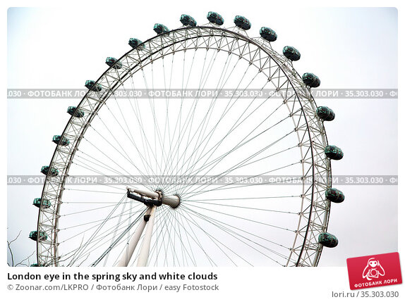 London eye in the spring sky and white clouds. Стоковое фото, фотограф Zoonar.com/LKPRO / easy Fotostock / Фотобанк Лори