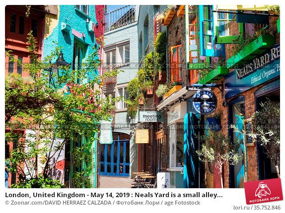 London, United Kingdom - May 14, 2019 : Neals Yard is a small alley... Стоковое фото, фотограф Zoonar.com/DAVID HERRAEZ CALZADA / age Fotostock / Фотобанк Лори