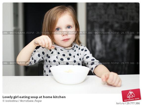 Купить «Lovely girl eating soup at home kitchen», фото № 29777386, снято 20 декабря 2018 г. (c) ivolodina / Фотобанк Лори
