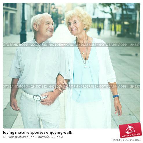 Купить «loving mature spouses enjoying walk», фото № 29337882, снято 27 августа 2017 г. (c) Яков Филимонов / Фотобанк Лори