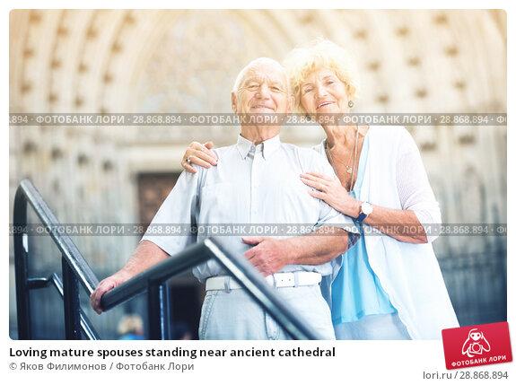 Купить «Loving mature spouses standing near ancient cathedral», фото № 28868894, снято 20 января 2019 г. (c) Яков Филимонов / Фотобанк Лори