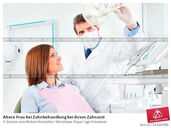 Ältere Frau bei Zahnbehandlung bei ihrem Zahnarzt. Стоковое фото, фотограф Zoonar.com/Robert Kneschke / age Fotostock / Фотобанк Лори