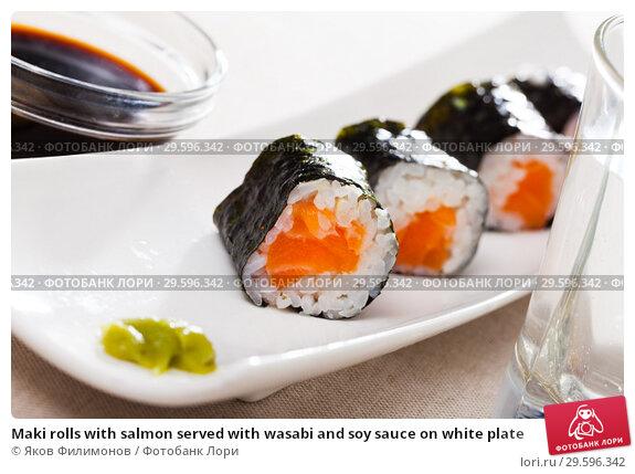 Купить «Maki rolls with salmon served with wasabi and soy sauce on white plate», фото № 29596342, снято 9 декабря 2019 г. (c) Яков Филимонов / Фотобанк Лори