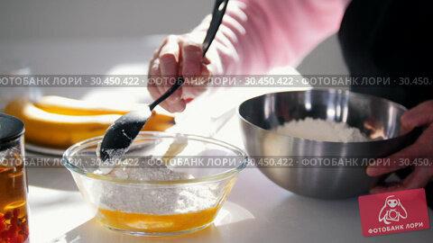 Making pancakes. An old woman adding flour in the dough. Стоковое видео, видеограф Константин Шишкин / Фотобанк Лори