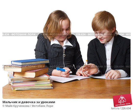 Купить «Мальчик и девочка за уроками», фото № 226634, снято 15 марта 2008 г. (c) Майя Крученкова / Фотобанк Лори
