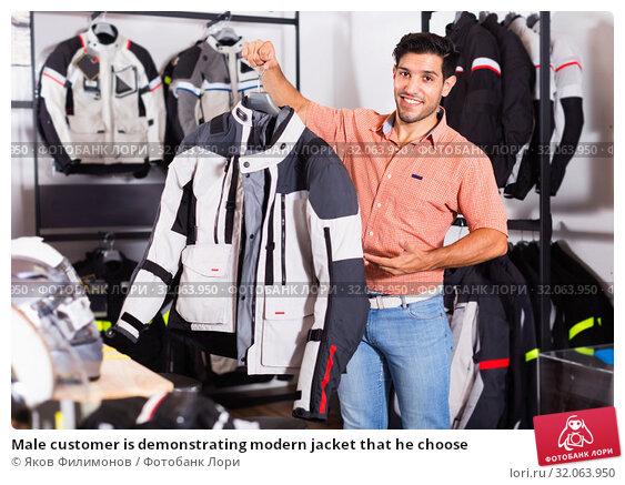 Male customer is demonstrating modern jacket that he choose. Стоковое фото, фотограф Яков Филимонов / Фотобанк Лори